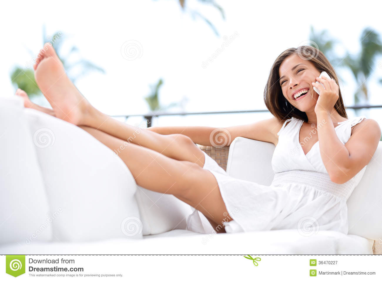 sitting pretty sofas rp sofa covers smart phone woman smiling talking happy on royalty
