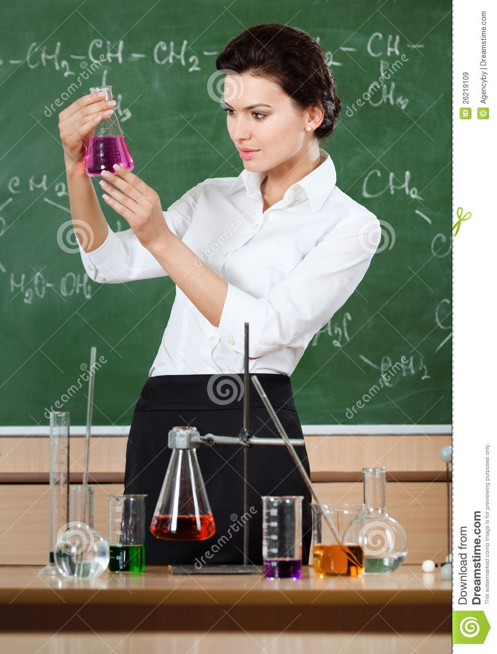 Smiley Chemistry Teacher Examines Conical Flask Royalty Free Stock Images  Image 26219109