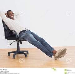 Office Sitting Chairs Trampoline At Target Smiling Afro Man On Chair In An Empty Room
