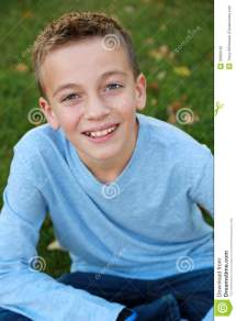 Smiling Boy In Natural Light Stock