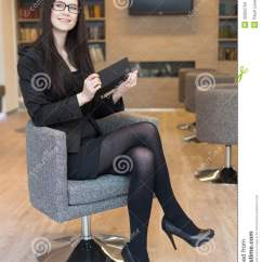 Office Chair For Standing Desk Posture Support Smiling Business Woman In Glasses Sits On A Stock Images - Image: 32655704