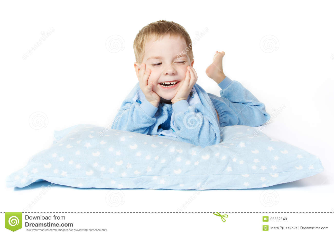 Smiling Child Lying Down With Pillow Stock Image  Image