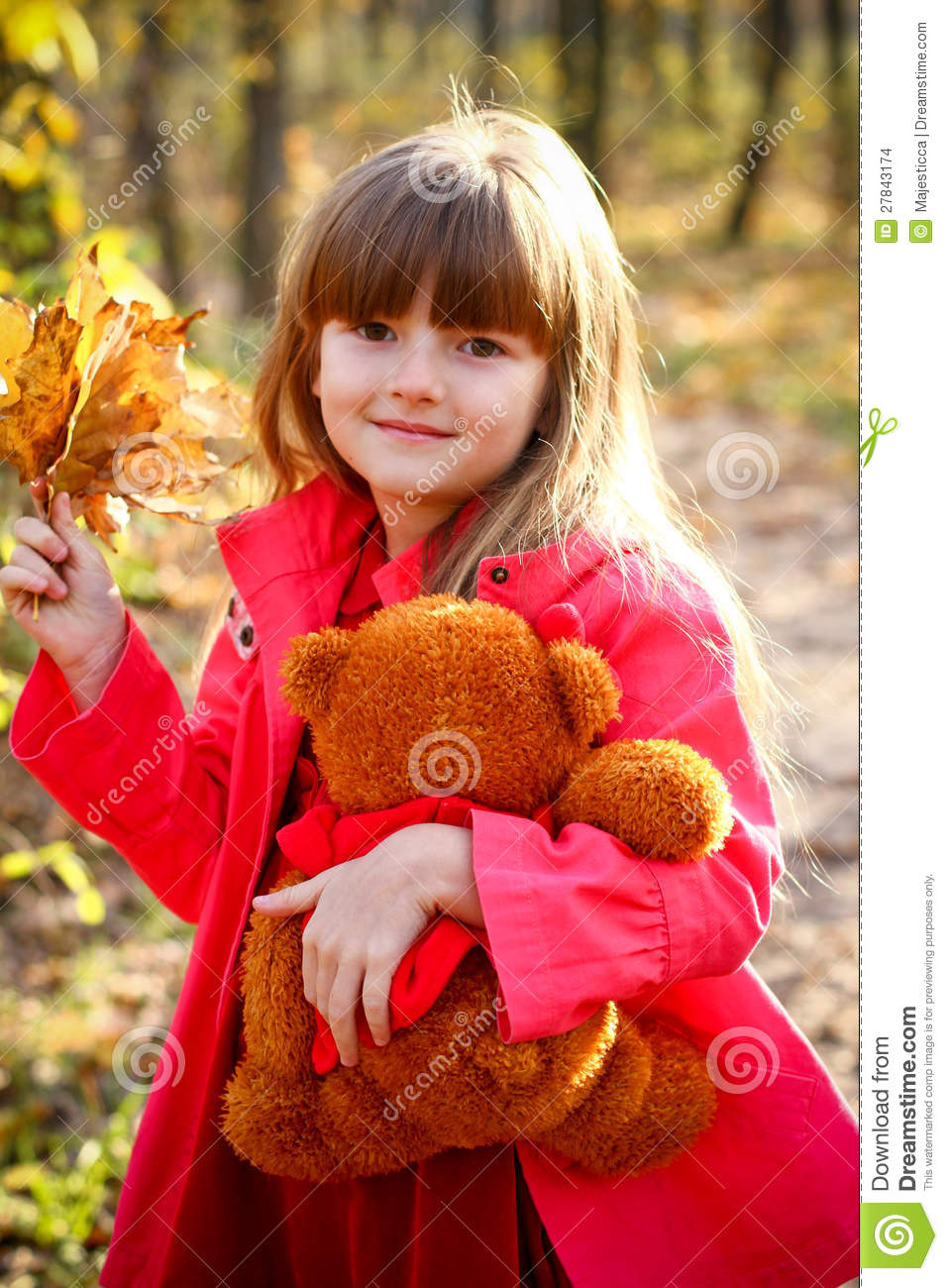 Smiling Girl With Maple Leaves And Teddy Bear Stock Images