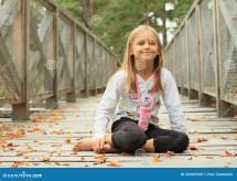Smiling Little Girl Sitting Barefoot