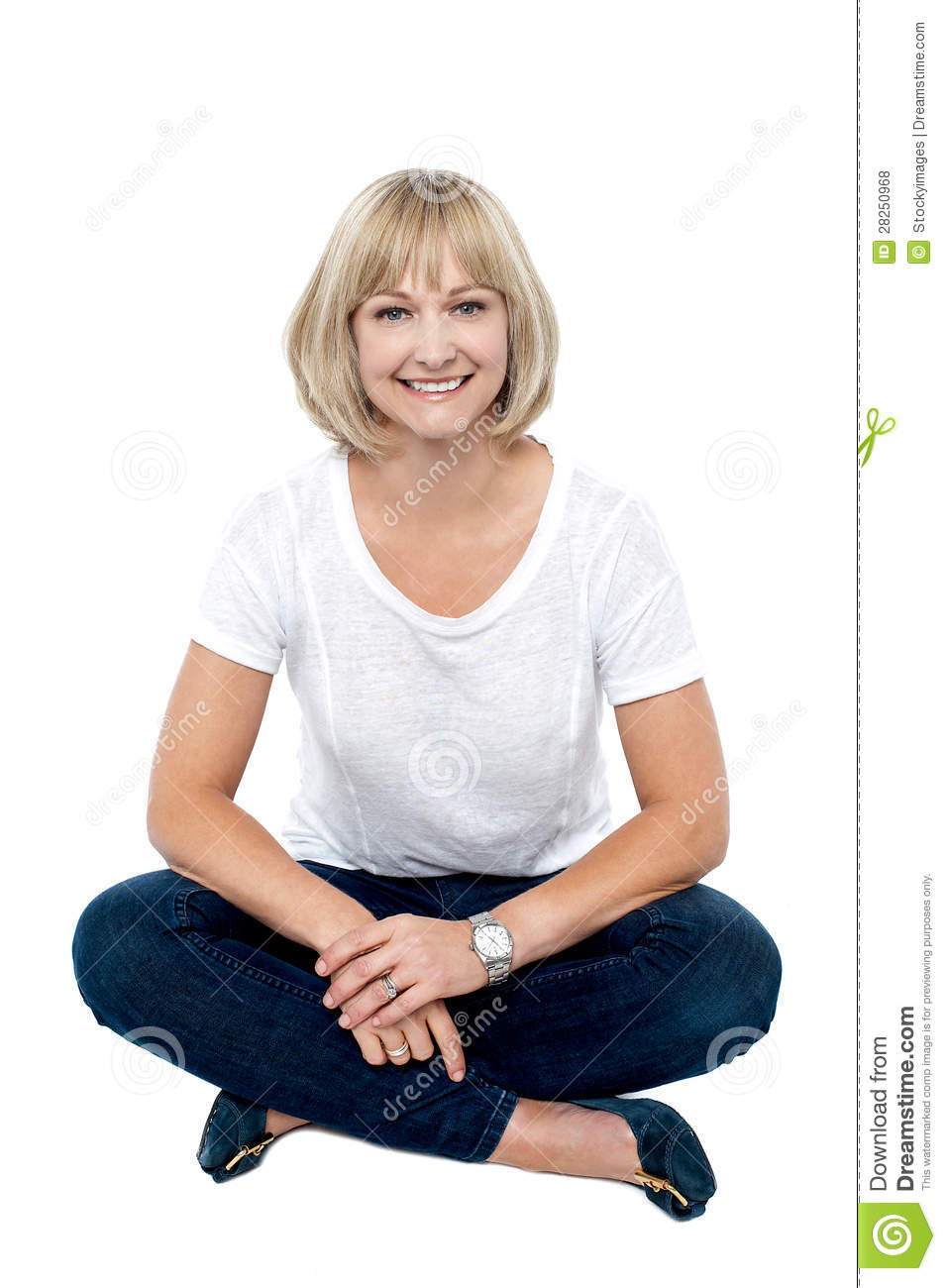 Smiling Middle Aged Woman Sitting On The Floor Royalty