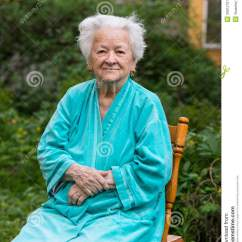 Old Lady Chair Baby Booster Smiling Womansitting On A Stock Image Of