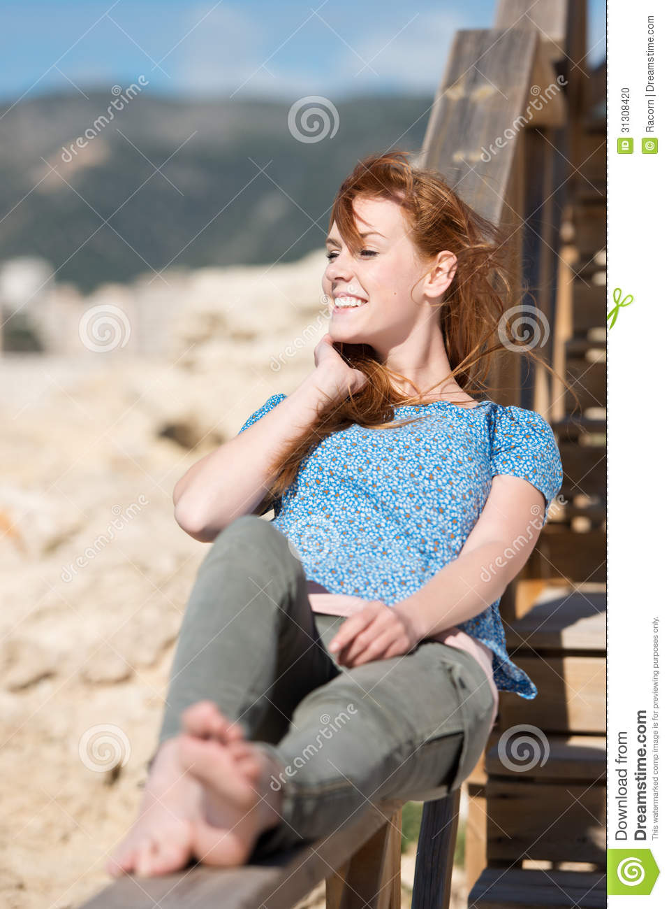 Smiling Woman Relaxing In The Sun Stock Photo  Image