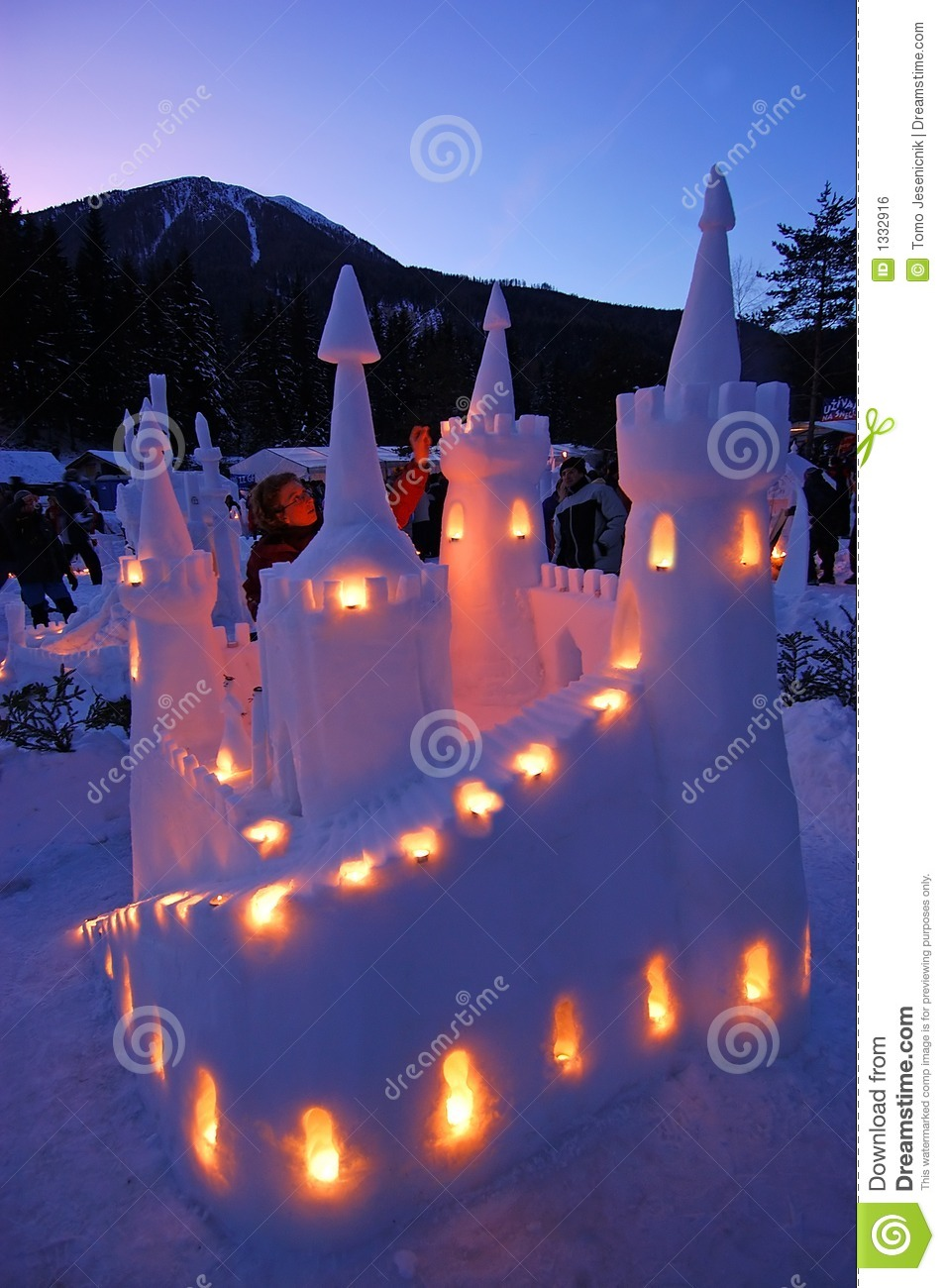 Snow Castle Lit By Candles And Twilight Royalty Free Stock