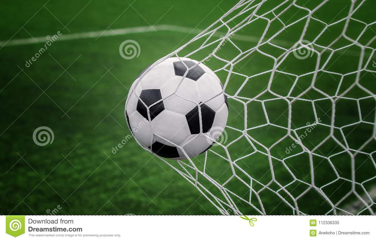 Soccer Ball On Goal With Net And Green Background Stock