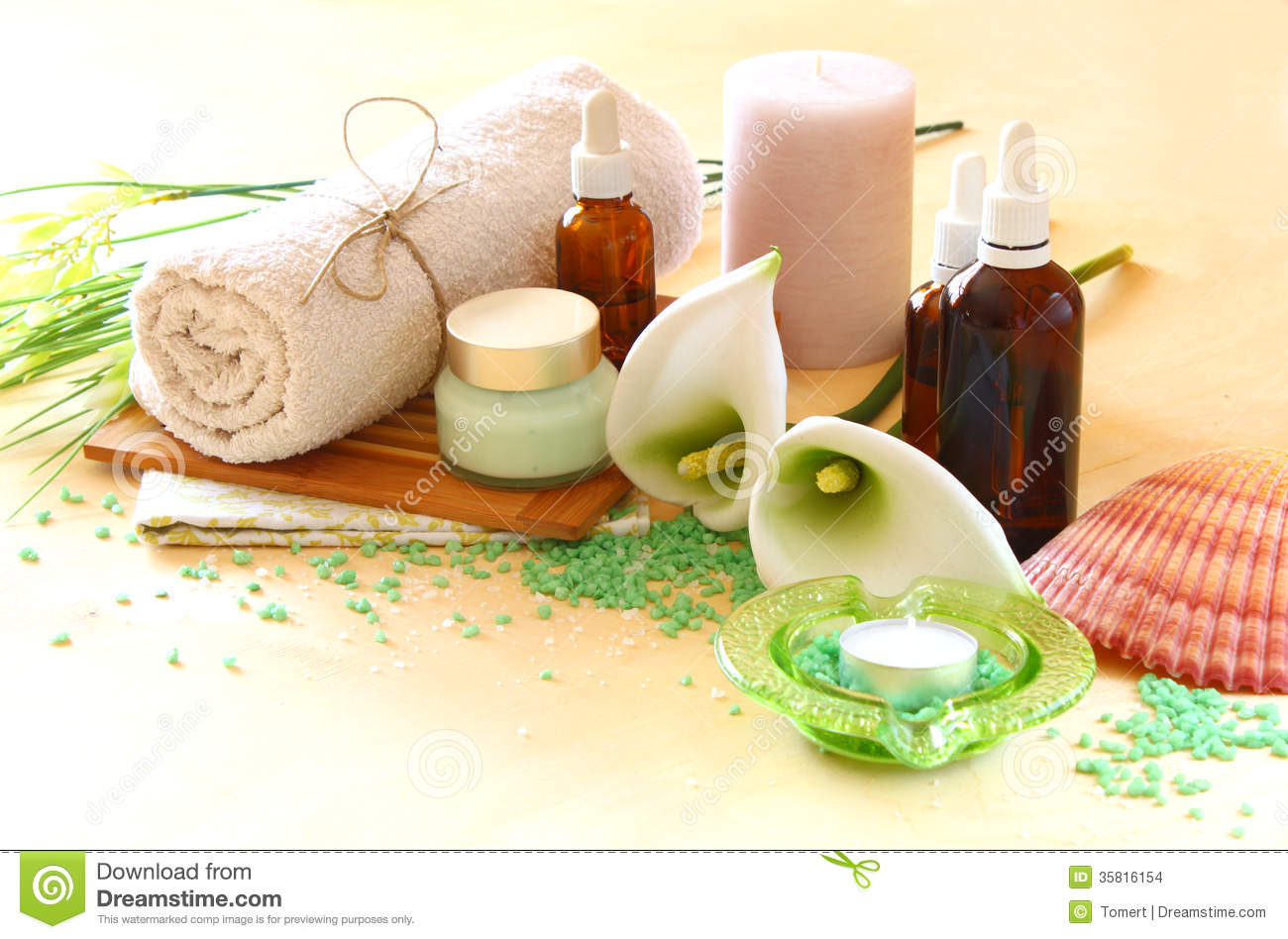 Spa And Wellness Setting With Natural Soap Candles And Towel Natural Wooden Background  Green