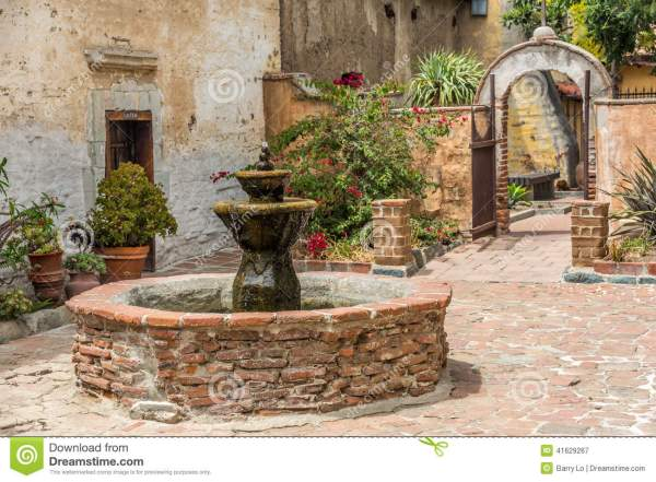 Spanish Mission Fountain In Courtyard Stock