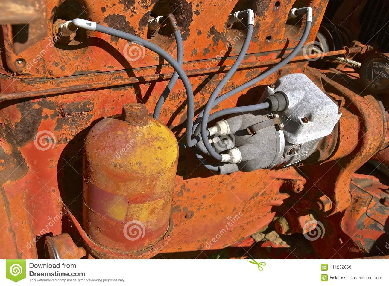 hight resolution of spark plug wiring of an old orange tractor