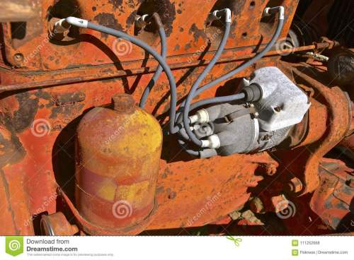 small resolution of spark plug wiring of an old orange tractor