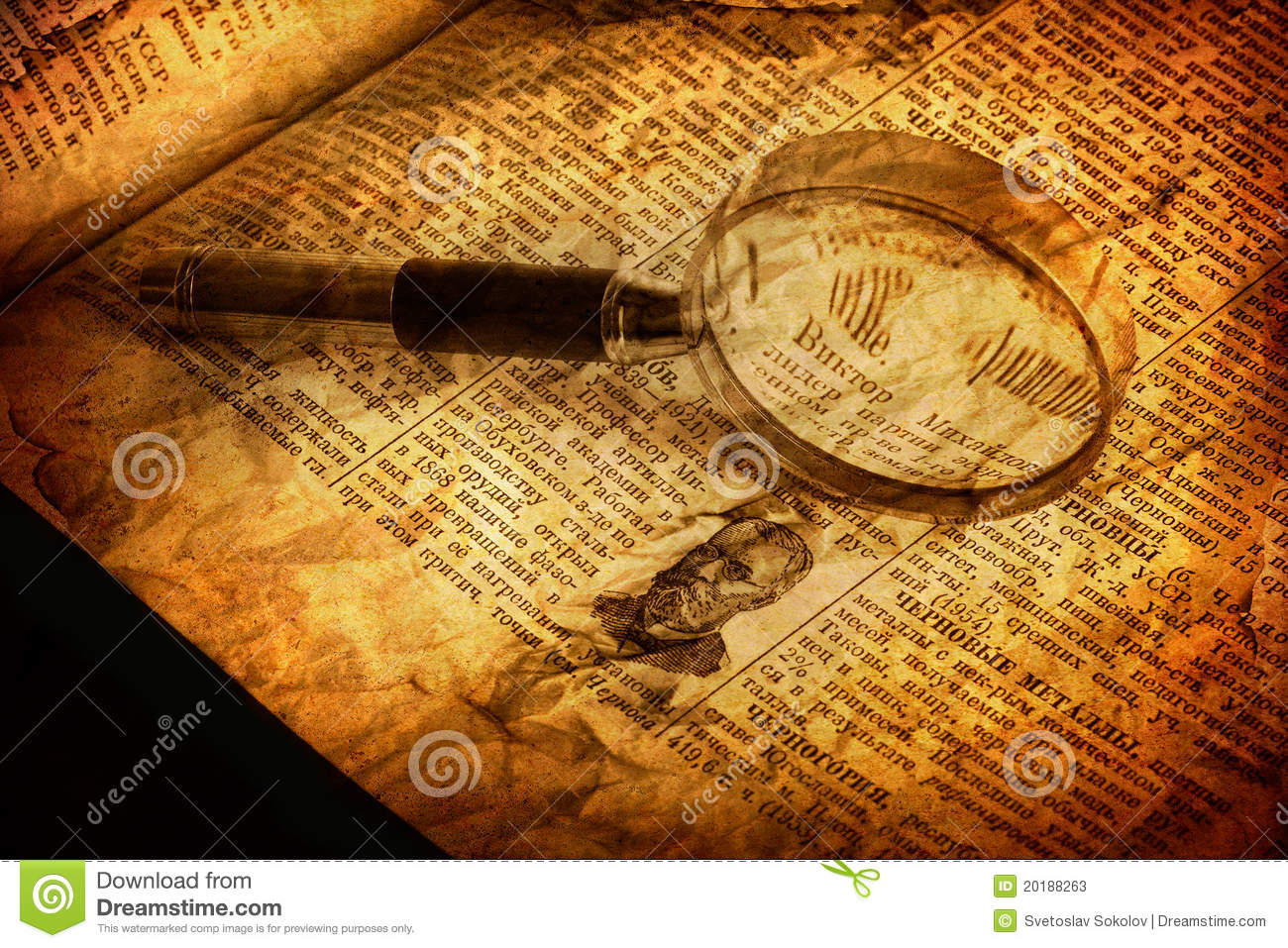 spyglass and old book
