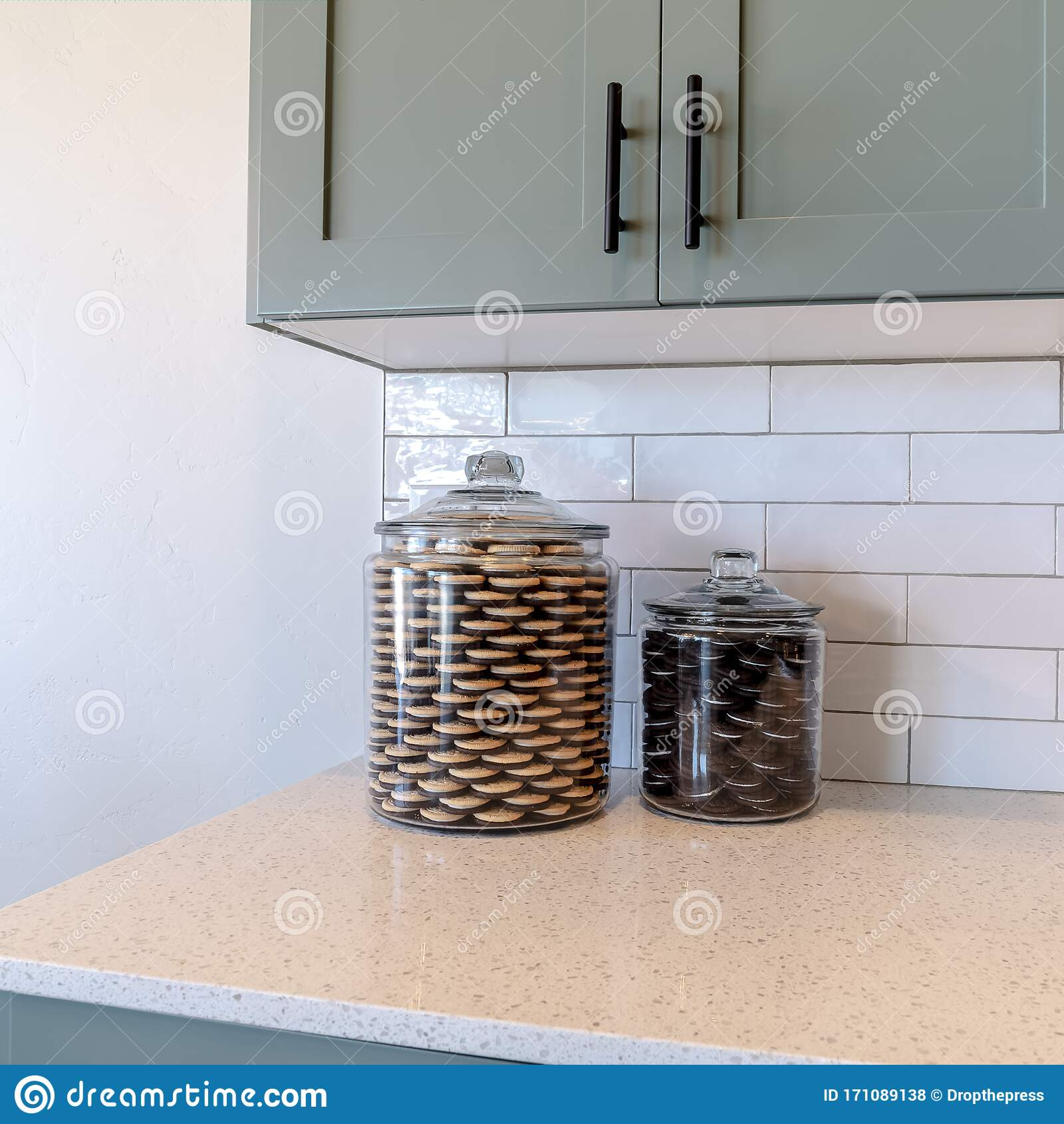 https www dreamstime com square jars cookies kitchen counter top against tile backsplash white wall electrical socket hangiing cabinets image171089138