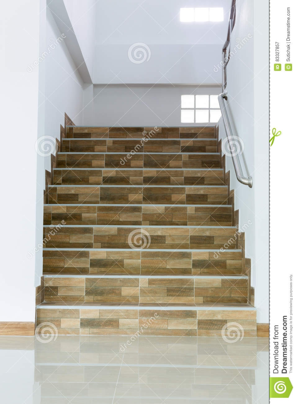 Staircase In Residential House With Stainless Steel Banister Stock | Floor Tiles Design For Stairs | Hallway Floor Tile | Stair Landing | House | Stair Riser | Wall