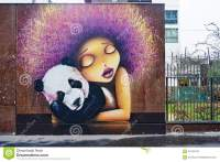 Street Art Wall Painting Of A Girl With A Panda In Paris
