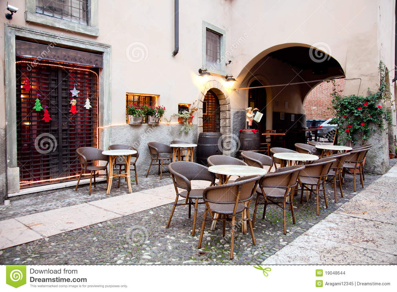 chair for dining table red tufted street restaurant in verona, italy stock photo - image: 19048644