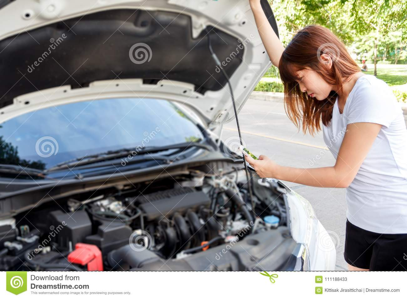 hight resolution of stressed woman taking photo of engine with mobile phone car breakdown