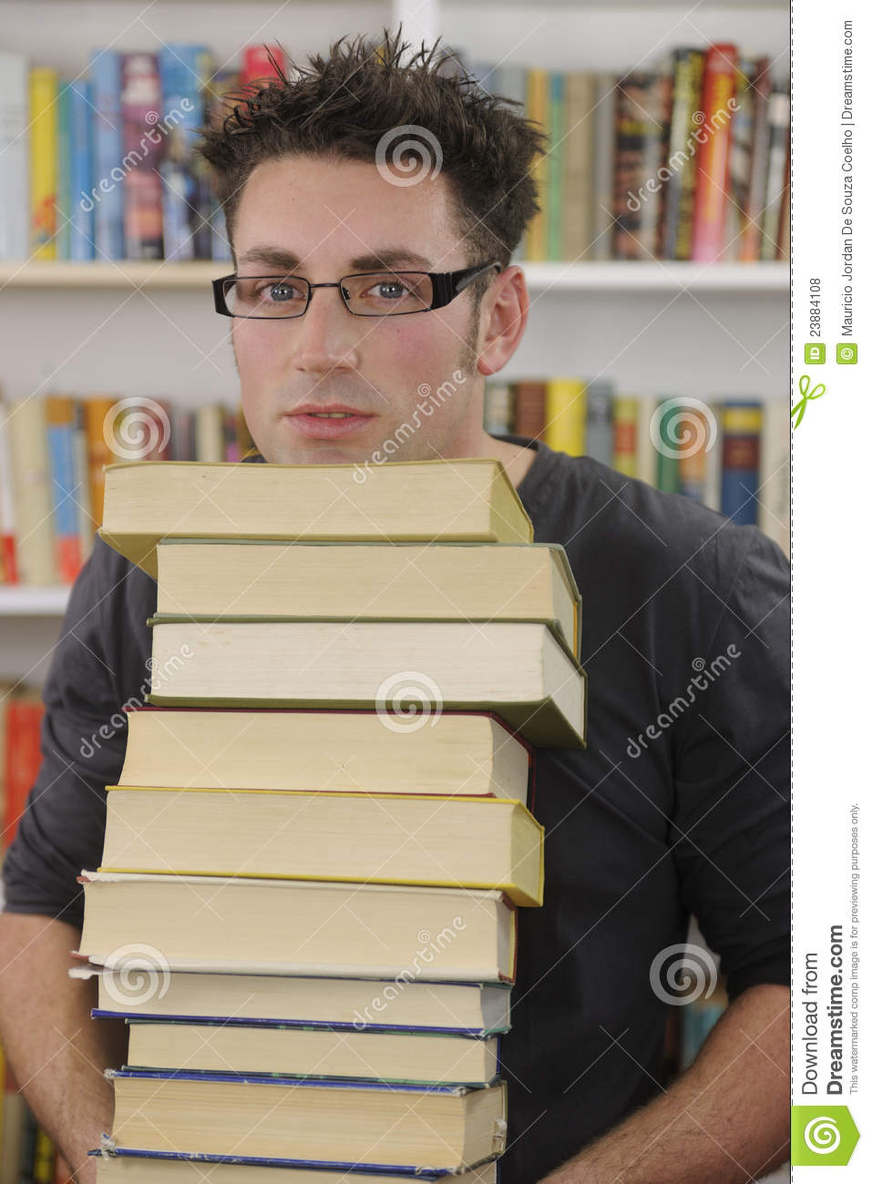 Student Carrying Stack Of Books In Library Royalty Free