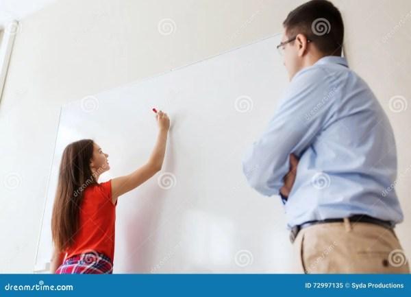 Student Writing Board And Teacher School Stock