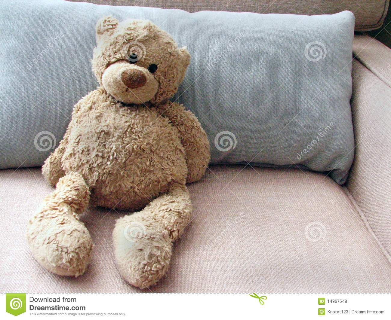 Stuffed Toy Teddy Bear On Couch With Pillow Stock Photo