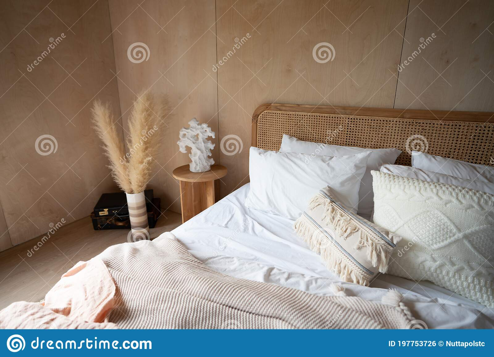 stylish bedroom corner with rattan headboard and bed with soft pillows setting with white pillows plywood wall on the background stock photo image of idea mirror 197753726