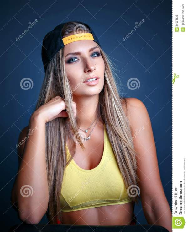Stylish Young Girl Leaned Wall Stock