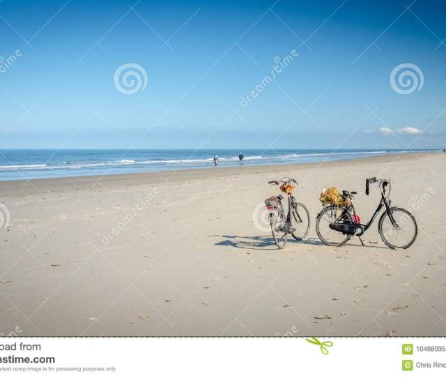 Two Bikes On The Schiermonnikoog Beach Waiting For Their Owners
