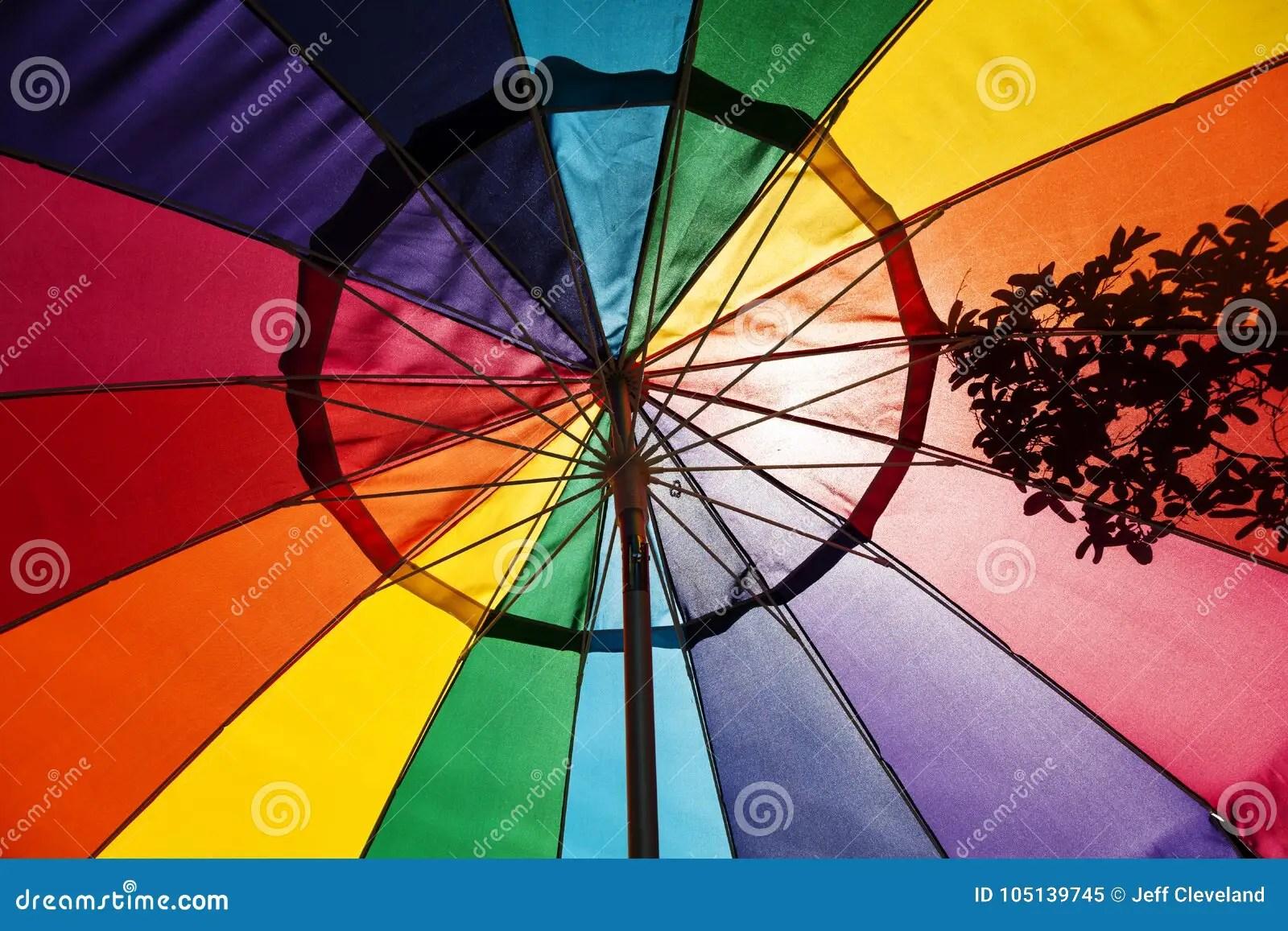 https www dreamstime com sunlight shining multi colored patio umbrella looking up sunlight hitting rainbow colored patio umbrella image105139745