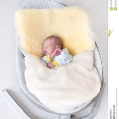 Swing Chair Newborn Plastic Outdoor Rocking Chairs Sweet Baby Boy In On A Sheepskin Stock Photo - Image: 41507057
