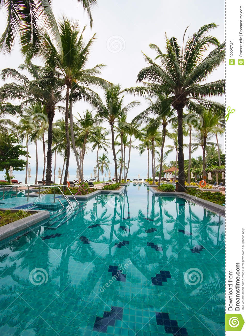 beach umbrella for chair office wheel replacement swimming pool beside the sea with coconut tree. royalty free stock images - image: 32225749