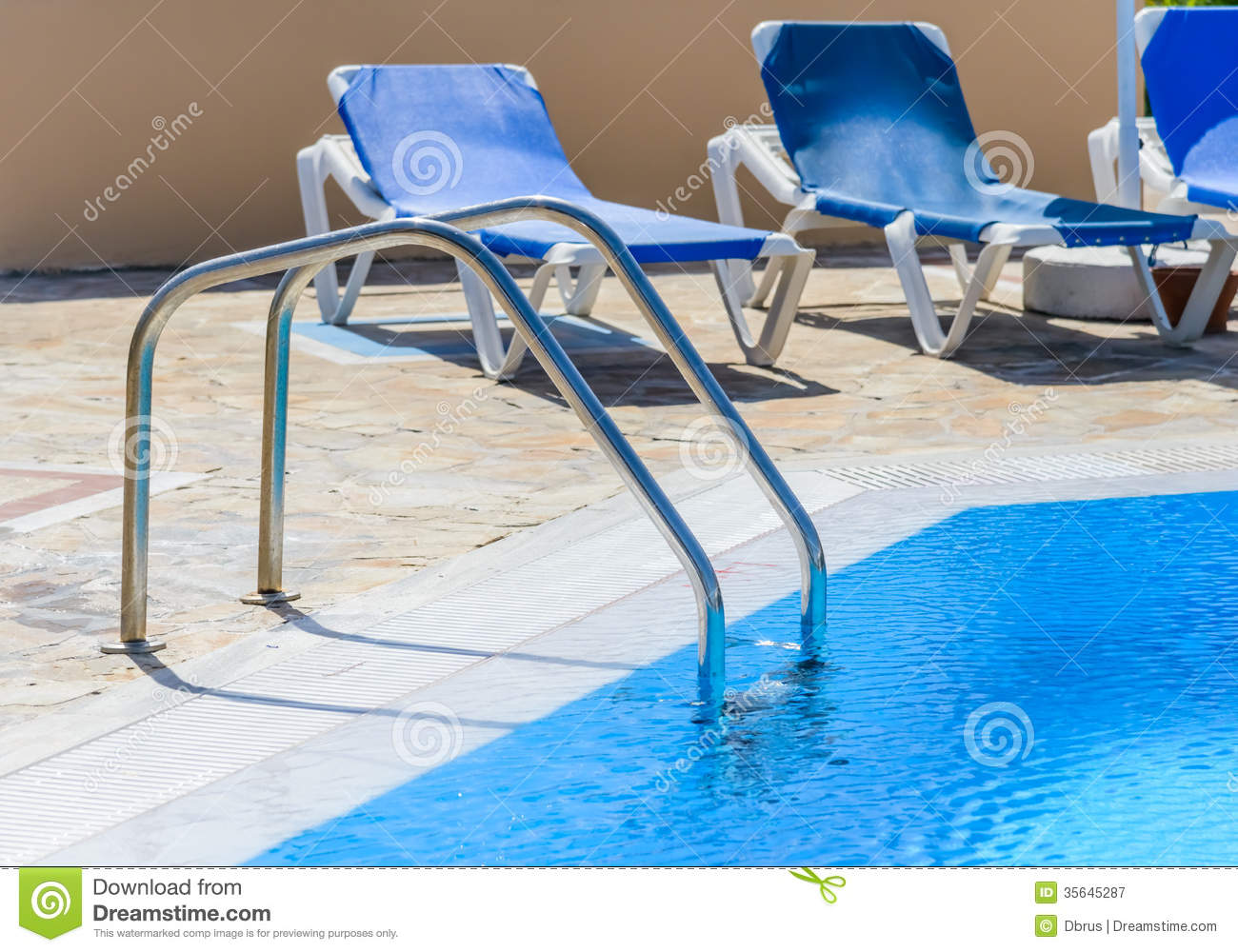 Pool Deck Chairs A Swimming Pool With Sun Loungers Stock Image Image