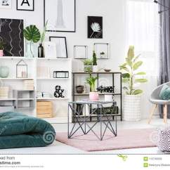 Living Room Mattress Diy Reupholster Chair Green And Pink Stock Image Of Design 113740059 Table On Rug In Modern Interior With Patterned Pouf Grey Armchair