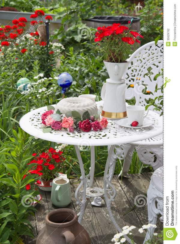 table set in garden with flowers
