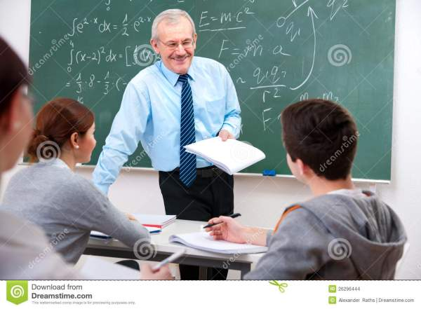 Teacher With Students In Classroom Stock - Of