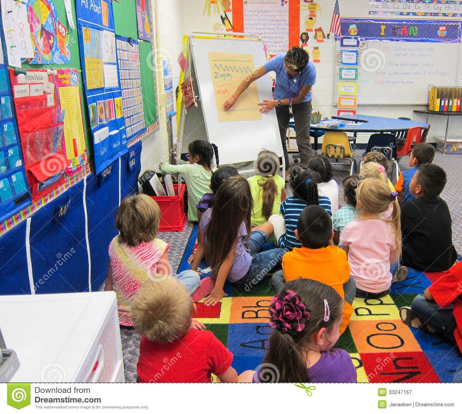 Teacher Teaching To Children Editorial Photography