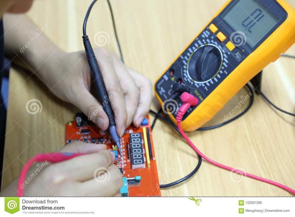 medium resolution of technician repairing computer hardware in the lab man use wiring diagram and multimeter
