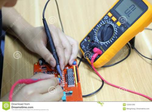 small resolution of technician repairing computer hardware in the lab man use wiring diagram and multimeter