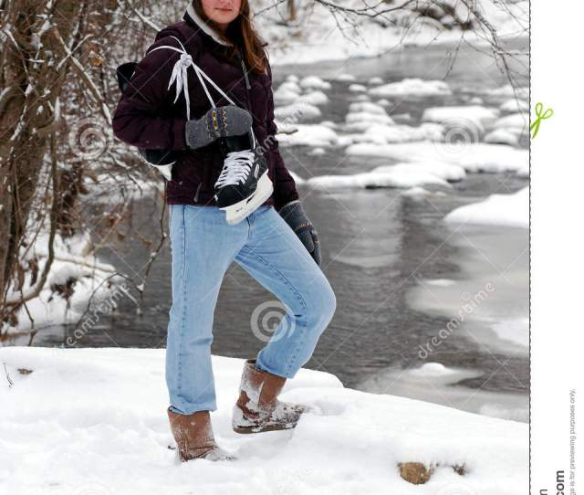 Ice Skater Teen Girl In Snow By Frozen River With Hockey Ice Skates
