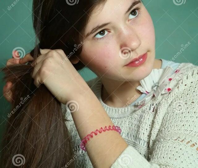 Teen Girl Plaiting Long Brown Thick Hair