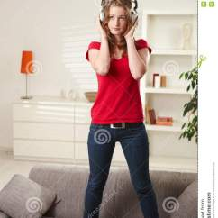 Red Couch Living Room Photos Cheap Mirrors Teen Girl Standing On With Headphones Stock Image ...