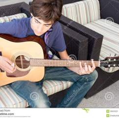Guitar Playing Chair Ikea Swivel Chairs Living Room Teenage Boy Acoustic Stock Image