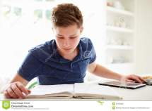 Teenage Boy Studying Digital Tablet Home Stock