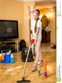 Teenage Girl Cleaning Floor At Living Room With Vacuum ...