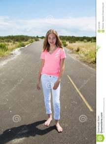 Teenage Girl Travels Barefoot Empty Road Stock