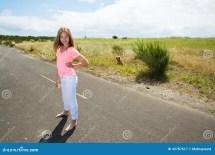 Teenage Girl Travels Barefoot Empty Road Stock