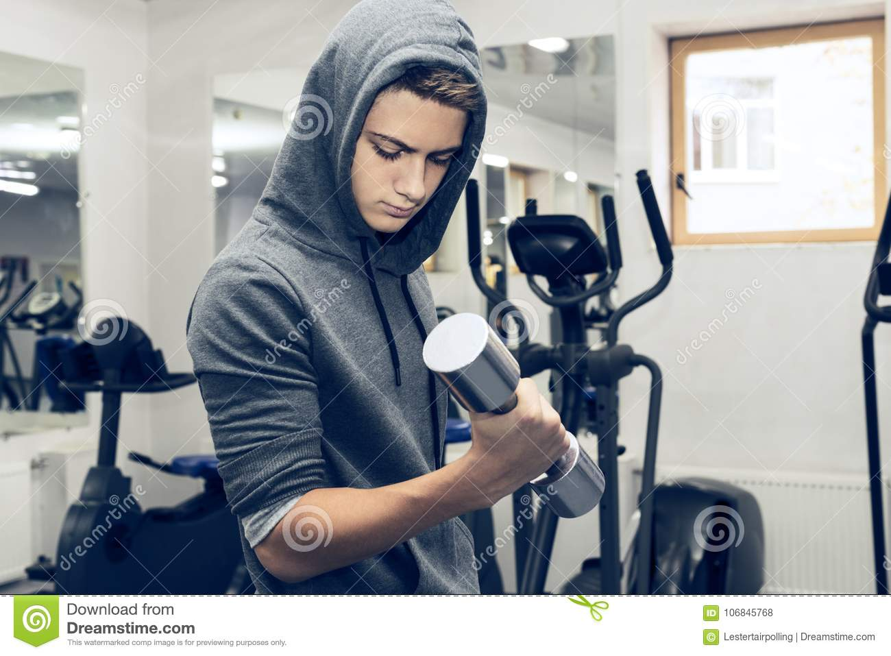The Teenager Is Engaged In Power Fitness Stock Photo