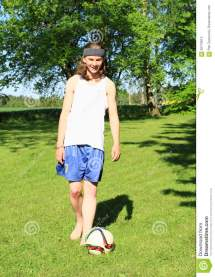 Barefoot Boy Playing Football