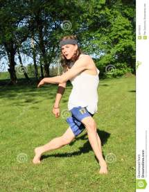 Teenager Playing Meadow - Discobolus Stock